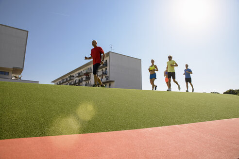 Small group of people running on grass - CUF26020