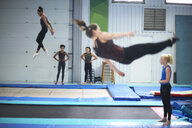 Young gymnasts practising moves - CUF26899