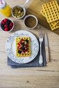 Waffle garnished with wild berries and muesli - GIOF03947