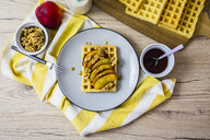 Waffle garnished with nectarine, walnuts and maple sirup - GIOF03953
