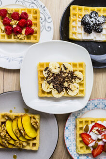 Plates of waffles with various toppings - GIOF03968