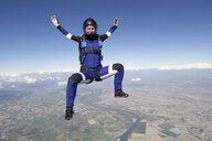 Freeflying skydiver in blue sky - CUF27192