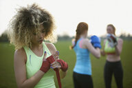 Three women exercising with boxing gloves in the park - CUF27363