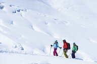 Three mature adult skiers on Mont Blanc massif, Graian Alps, France - CUF27429