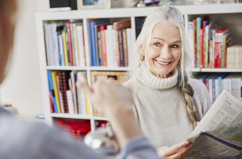 Senior woman reading newspaper - CUF27672