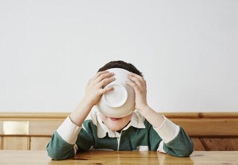 Boy drinking milk from bowl - CUF27678