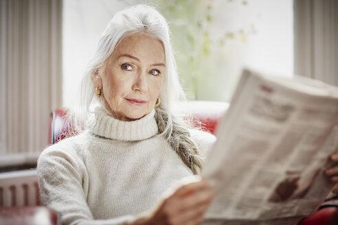 Senior woman reading newspaper - CUF27684