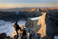 Austria, Tyrol, Zillertal Alps, View from Reichenspitze, climber at glaciated mountains at sunrise, Wildgerlostal, High Tauern National Park - CVF00742