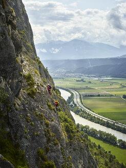 Austria, Tyrol, two rock climbers in Martinswand - CVF00750