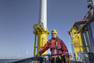 Portrait of engineer on boat on offshore wind farm - CUF28095