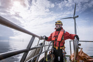 Portrait of engineer on boat at offshore windfarm - CUF28188
