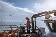 Engineer on deck of service boat at offshore windfarm - CUF28194