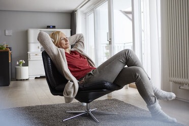 Happy woman relaxing at home - RBF06294
