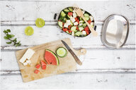 Lunch box, preparation of watermelon salad with feta, cucumber, ment and lime dressing - LVF07068