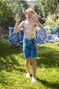 Boy in the garden splashed with water - SARF03775