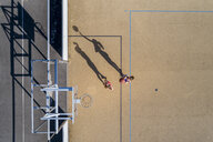 Young women playing basketball, aerial view - STSF01616