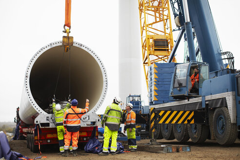 Engineers working on wind turbine - CUF28480