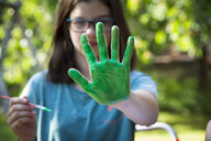 Girl's green painted hand - LVF07084
