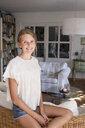 Portrait of pretty teenage girl in living room - CUF28643