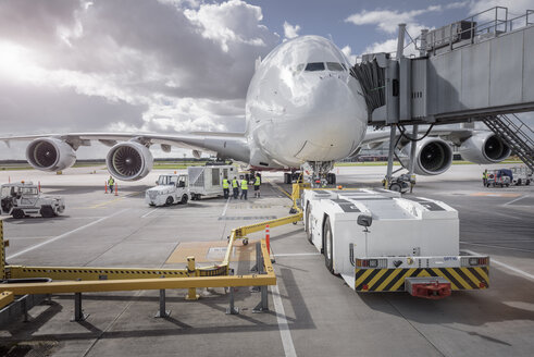 Ground crew operating loading equipment on A380 aircraft - CUF28723