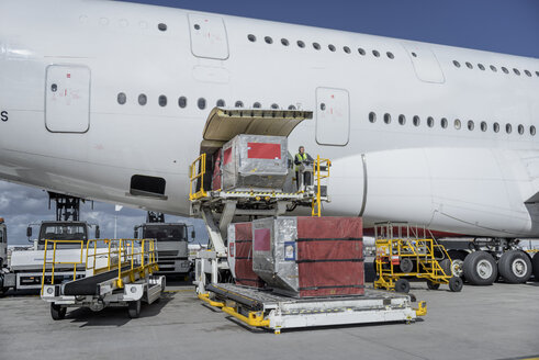 Ground crew loading freight and luggage into A380 aircraft - CUF28741