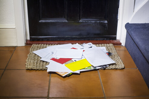 Pile of mail on doormat - CUF28929