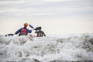 Two people sea kayaking - CUF28959