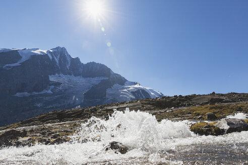 Austria, Carinthia, Großglockner peak and high alpine territory with stream, High Tauern National Park - GWF05542