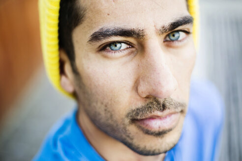 Portrait of young man with blue eyes and stubble - JATF01052