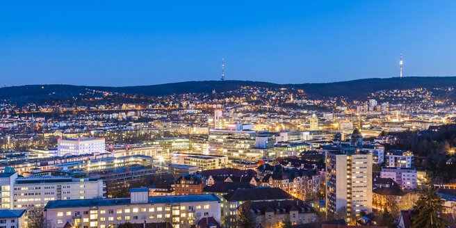 Germany, Stuttgart, panoramic cityscape with TV tower in the evening, blue hour - WDF04685