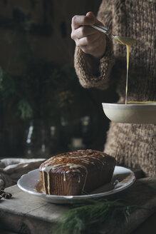 Woman preparing home-baked Christmas cake, partial view - ALBF00372