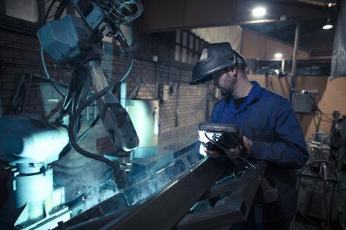 Welder welding metal with robot - OCAF00289