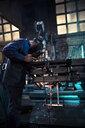 Welder welding metal with robot - OCAF00292