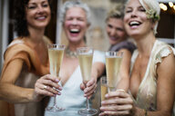 Elegant mature women toasting in urban garden - CUF29604
