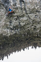 Low angle view of male climber climbing the route Lunatic on Moon Hill in Yangshuo, Guangxi Zhuang, China - CUF29859
