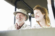 Portrait of senior man and daughter on safari in four wheel drive, Kafue National Park, Zambia - CUF30126