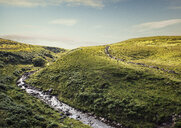 River flowing through rolling landscape, Brecon Beacons, Wales, UK - CUF30297