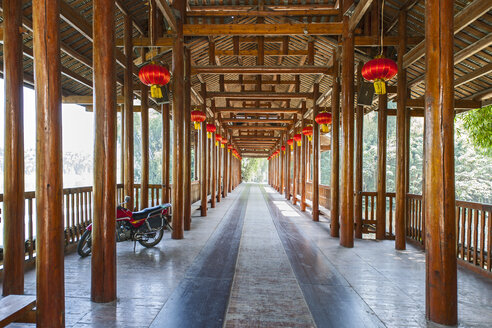 Open sided wooden structure with red lanterns, Yangshuo, Guangxi Zhuang, China - CUF30435