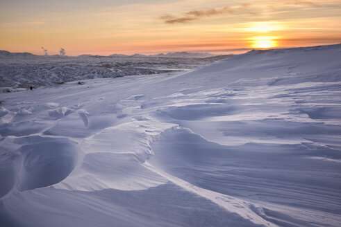 Windswept snow covered field at sunset, Skalafell, Iceland - CUF30495