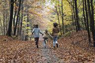 Girls running in autumn forest - CUF30521