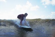 Male surfer riding wave - CUF30653
