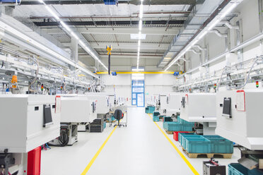 Empty factory production line with rows of work stations - CUF30962