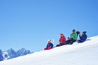 Family resting on snow, Chamonix, France - CUF31238