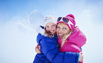Mother and daughter hugging, Chamonix, France - CUF31268