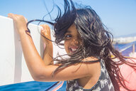 Cute girl with windswept hair on boat trip, Tarifa, Spain - CUF31343