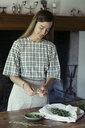 Young woman cleaning fresh tarragon - ALBF00443