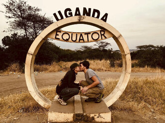 Uganda, Couple kissing at the equator - REAF00278