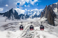 Elevated view of three cable cars over snow covered valley at Mont blanc, France - CUF31360