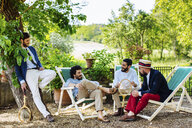 Group of male friends, relaxing outdoors, laughing - CUF31477