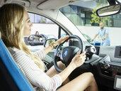Smiling woman driving electric car - CVF00787